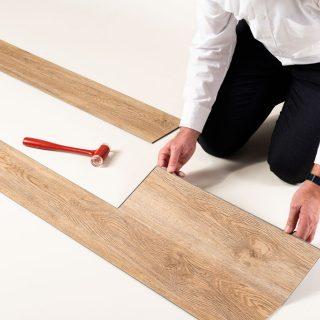 Man putting wooden tiles together