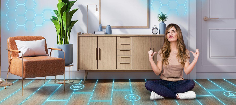 A woman sitting down cross legged on a tiled floor