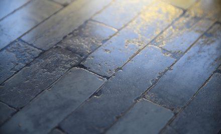 An outside tiled floor made of brick