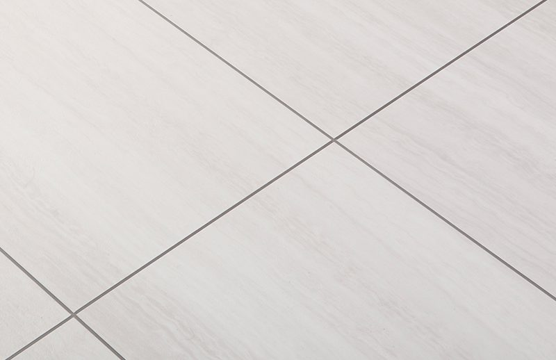 A close up of tiling in place as a floor